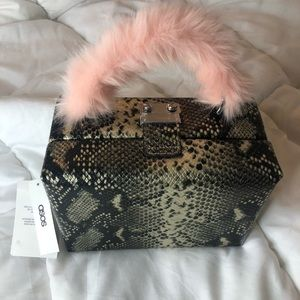 Snake print box bag with fur handle